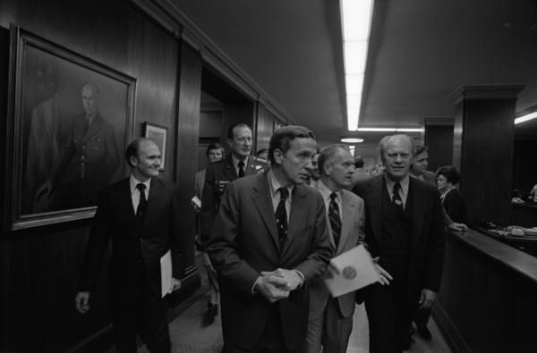 President Gerald Ford, Secretary Martin Hoffmann, Deputy Secretary of Defense William Clements, General Fred Weyend, and National Security Advisor Brent Scowcroft attend a ceremony to dedicate the George C. Marshall Corridor in memory of General Marshall, 4/20/1976.