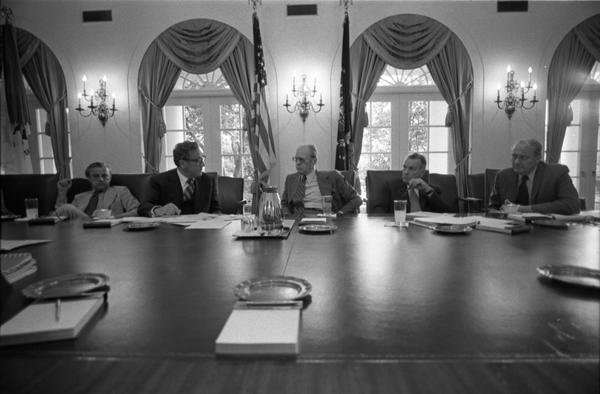 Ambassador L. Dean Brown, Secretary of State Henry Kissinger, President Gerald Ford, Deputy Secretary of Defense William Clements, and Secretary John Marsh attend a meeting of the National Security Council in the White House Cabinet Room, 6/17/976.