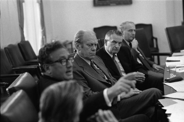 President Gerald Ford, Secretary of State Henry Kissinger, Deputy Secretary of Defense William Clements, Ambassador L. Dean Brown, Secretary John Marsh, and White House Chief of Staff Richard Cheney attend a meeting of the National Security Council in the White House Cabinet Room, 6/17/976.