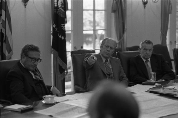 President Gerald Ford, Secretary of State Henry Kissinger, Deputy Secretary of Defense William Clements, and National Security Advisor Brent Scowcroft attend a meeting of the National Security Council in the White House Cabinet Room, 6/17/976.