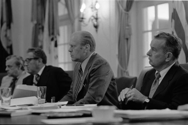 Ambassador L. Dean Brown, Secretary of State Henry Kissinger, President Gerald Ford, and Deputy Secretary of Defense William Clements attend a meeting of the National Security Council in the White House Cabinet Room, 6/17/976.