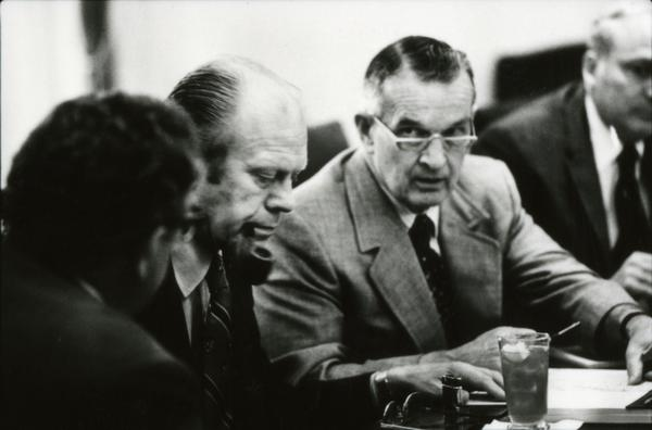 President Gerald Ford, Secretary of State Henry Kissinger, Deputy Secretary of Defense William Clements, and Secretary John Marsh attend a meeting of the National Security Council in the White House Cabinet Room, 6/18/976.