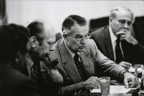 President Gerald Ford, Secretary of State Henry Kissinger, Deputy Secretary of Defense William Clements, and Secretary John Marsh attend a meeting of the National Security Council in the White House Cabinet Room, 6/18/1976.