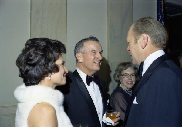 President Gerald Ford, Deputy Secretary William Clements, and Mrs. Clements prior to a dinner for the Secretary of Defense, Service Secretaries, Joint Chiefs of Staff, and Commanders or the Unified Commands in the White House Grand Hall, 12/11/1976.