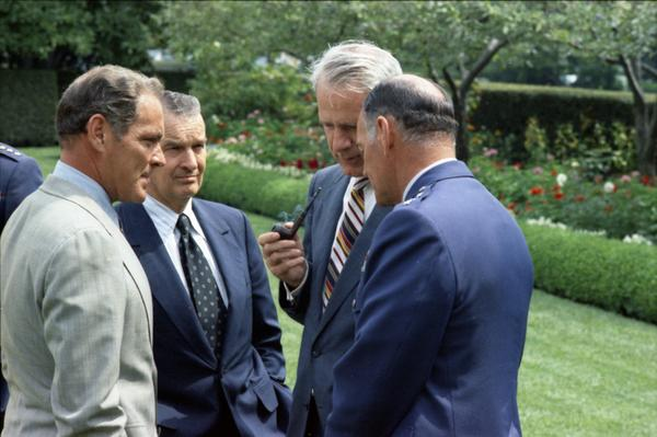 Chief of Staff Alexander Haig, Secretary of Defense James Schlesinger, General George Brown, and Assistant Secretary of Defense William Clements after Scowcroft's promotion ceremony to Lieutenant General in the White House Rose Garden, 9/5/1974.