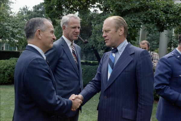 President Gerald Ford, Assistant Secretary of Defense William Clements, and Secretary Schlesinger attend Brent Scowcroft's promotion ceremony to Lieutenant General in the White House Rose Garden, 9/5/1974.
