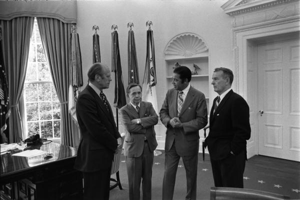 President Gerald Ford, Assistant Secretary of Defense William Clements, Representative Carl Albert, and Senator Edward Brooke discuss the Combined Federal Campaign in the Oval Office, 9/17/1974.