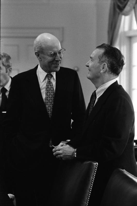 Deputy Secretary of State Robert Ingersoll and Deputy Secretary of Defense William Clements speak prior to a National Security Meeting in the White House Cabinet Room, 10/18/1974.