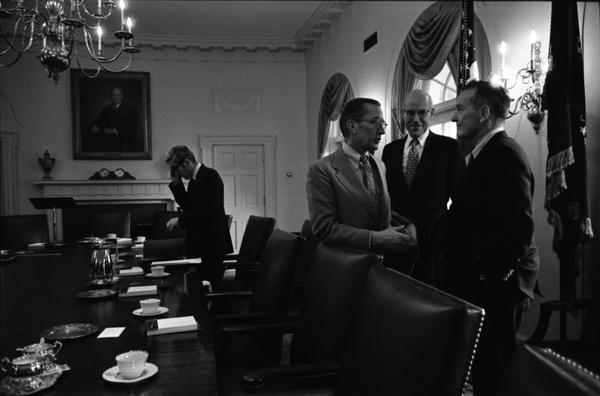 CIA Director William Colby, Deputy Secretary of Defense William Clements, and Deputy Secretary of State Robert Ingersoll speak prior to a National Security Meeting in the White House Cabinet Room, 10/18/1974.
