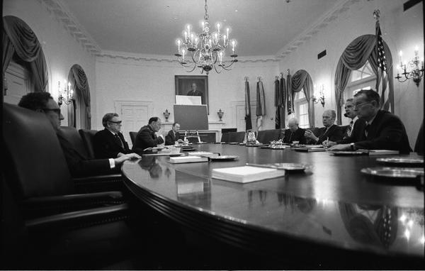 Gerald Ford, Robert Ingersoll, James Schlesinger, William Clements, General George S. Brown, William Colby, Nelson Rockefeller, Henry Kissinger, and Brent Scowcroft attend a National Security Meeting in the White House Cabinet Room, 4/24/1975.