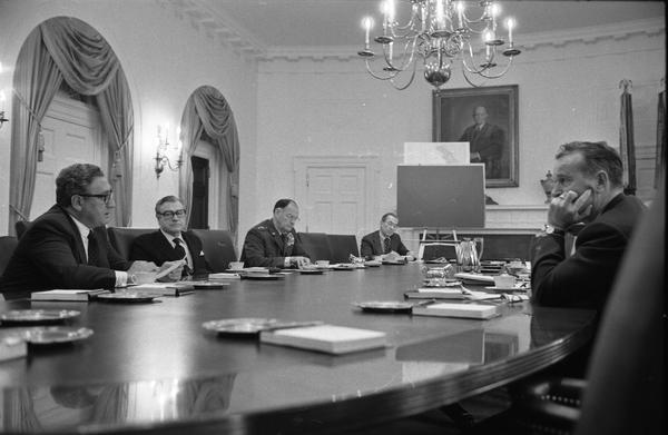 Gerald R. Ford, Henry Kissinger, James Schlesinger, Robert Ingersoll, William Clements, Brent Scowcroft, Robert Hartmann, and John Marsh attend a National Security Council meeting in the White House Cabinet Room, 8/10/1974.