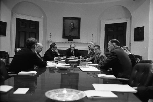 Gerald Ford, Nelson Rockefeller, Henry Kissinger, James Schlesinger, General George S. Brown, William Colby, Robert Ingersoll, William Clements, Brent Scowcroft, and W. R. Smyser attend a National Security Meeting in the White House Roosevelt Room, 4/28/1975.