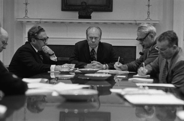 Gerald Ford, Nelson Rockefeller, Henry Kissinger, James Schlesinger, General George S. Brown, William Colby, Robert Ingersoll, and William Clements attend a National Security Meeting in the White House Roosevelt Room, 4/28/1975.