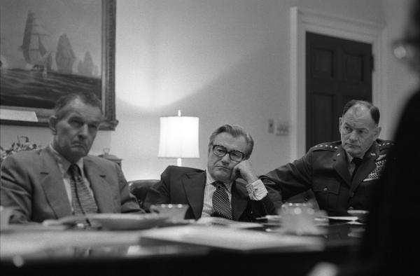 Nelson Rockefeller, General George S. Brown, and William Clements attend a National Security Meeting in the White House Roosevelt Room, 4/28/1975.