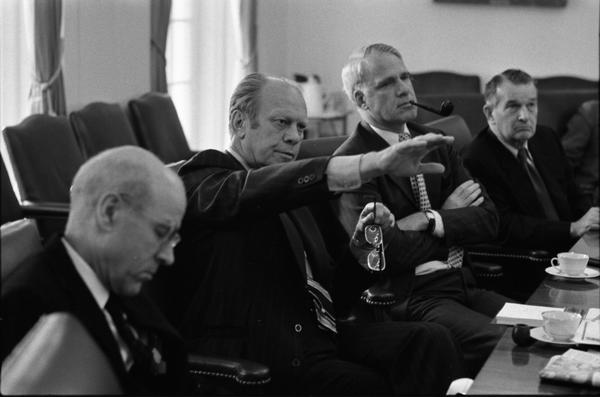 Robert Ingersoll, Gerald Ford, James Schlesinger, and William Clements attend a National Security Council Meeting regarding the seizure of the SS Mayaguez in the White House Cabinet Room, 5/14/1975.