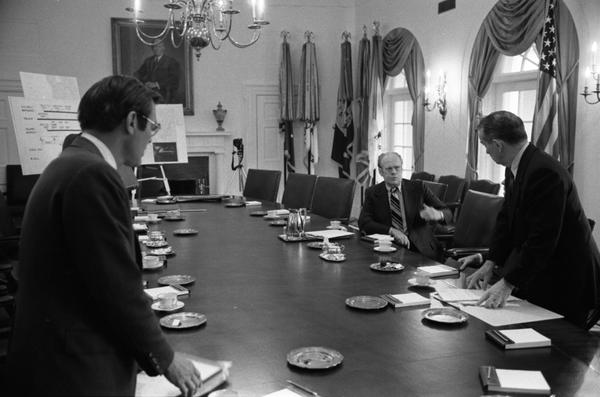 Gerald Ford, William Clements, and Donald Rumsfeld speak following a National Security Council Meeting regarding the seizure of the SS Mayaguez in the White House Cabinet Room, 5/14/1975.