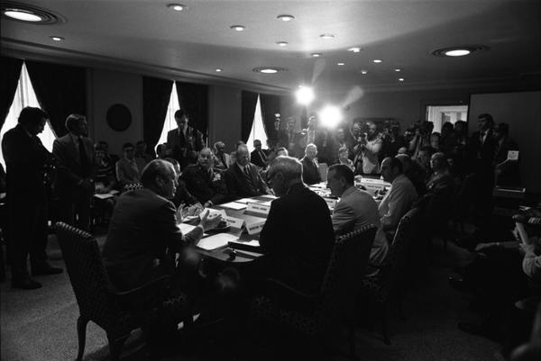 Gerald Ford, Paul O'Neill, James Schlesinger, General George S. Brown, William Clements, Martin R. Hoffmann, Donald Ogilvie, Brent Scowcroft, Howard Graves, William Greener, and Armed Forces Policy Council Members attend a meeting with the Armed Forces Policy Council in the Pentagon dining room, 7/15/1975.