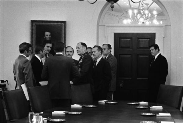 Gerald Ford, Donald Rumsfeld, William Clements, General John Wickham, Terence McClary, Leonard Sullivan, Richard Cheney, Brent Scowcroft, James Lynn, Paul O'Neill, Donald Ogilvie, Dale McOmber, and General George S. Brown attend a meeting with the Joint Chiefs of Staff and the Secretary of Defense to discuss the 1977 United States budget, 12/13/1975.