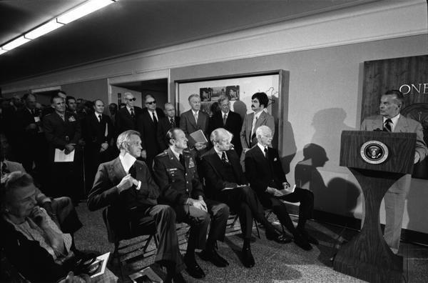 Deputy Secretary of Defense William Clements, American Red Cross President George Elsey, US Army Chief of Staff General Fred Weyend, and Ambassador at Large Ellsworth Bunker attend a ceremony to dedicate the George C. Marshall Corridor in memory of General Marshall, 4/20/1976.